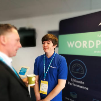 Photo of Pete on our 34SP.com WordCamp Dublin Stand